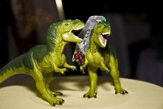 20) Something You - Dinosaur wedding cake toppers! I am in nerd love with this adorable T-rex couple! #modcloth #wedding
