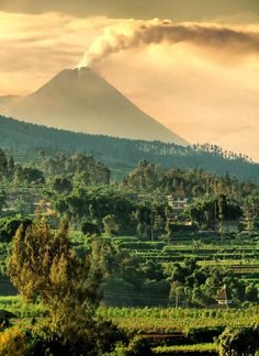 """Mount Merapi seen from the city of Salatiga, Central Java, Indonesia"" Laos, Vietnam, Yogyakarta, Places To Travel, Places To See, Places Around The World, Around The Worlds, Mount Merapi, Philippines"