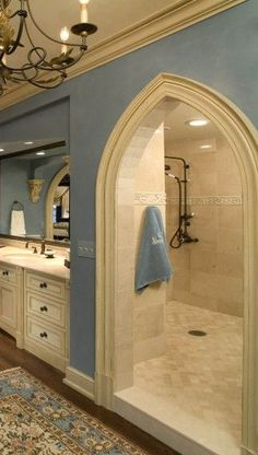 Shower behind the sinks...... It's kinda like a cave......& you don't have to worry about cleaning shower door. Love it!