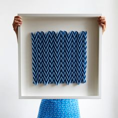 This intricate 3D origami artwork is handmade in London using an exclusive dark blue protopaper. The design is a twist on the traditional chevron fold, creating beautiful tonal variations. The framed origami artwork is a limited edition of 10 and each one is numbered and signed by the designer, Kyla