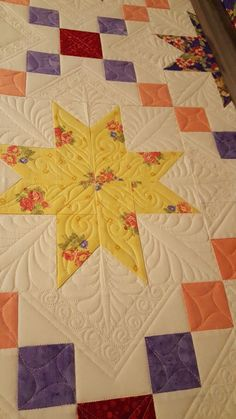 Latest quilt on the frame. Chain and Stars.