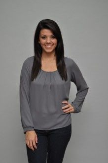 The classic style of this long sleeve grey top makes this piece a wise addition for your wardrobe. The semi-sheer fabric has a pleated neckline that adds a feminine touch to this blouse. Pair it with jeans and boots for a casual look or put on your pumps to dress it up! 100% polyester. Made in USA.$38