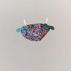 Maillot de bain à nœuds  Liberty fille bleu turquoise Saint - Lunaire. A partir de 19,90€ sur le site web http://www.unesourisaparis.com/