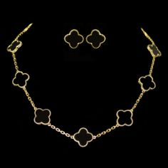 Van Cleef Alhambra Style Set. Necklace and earring set accompanied by clover shaped Black Onyx. This necklace is set in 18 karat Yellow Gold. Can be sold separately.