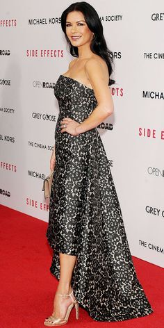 Catherine Zeta-Jones walked the Side Effects red carpet in a printed lace Michael Kors gown and nude Jimmy Choo sandals.