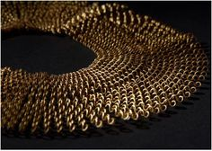 Saharan Refugees Recycle Plastic Bottles for Faux Gold Jewelry ~ The Beading Gem's Journal The bottles are painted, cut into strips which are then wound around nails placed in wooden boards. Hot sand is then poured over the design. The heat treatment shrinks the plastic which conforms to the pattern formed by the nails