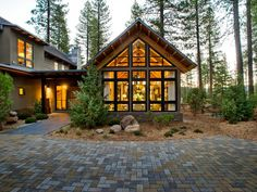 "Bourke's vision was to recreate the ""sensibility of the classic Tahoe cabin.""  The great room (pictured here) has the dining, kitchen, and living space ""all within a form that is reminiscent of that rustic, Tahoe style,"" Bourke says.    http://www.hgtv.com/dream-home/front-yard-pictures-from-hgtv-dream-home-2014/pictures/page-2.html?soc=pindhm"