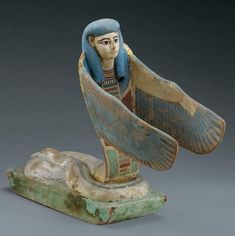 Winged Snake Deity  With wings and a human head, this wooden snake-deity figurine is from the tomb of Pharaoh Amenhotep II (1427 to 1400 B.C.)....se