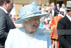 This brooch is fabulous. Queen Elizabeth II speaks with a guests at a garden party at Buckingham Palace on June 1, 2017.