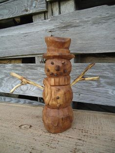 This snowman was all hand carved, the snowman itself is made out of Elm wood which is very unique in color and wood grain. The pieces were made out of black walnut wood for the nose, eyes and buttons were each individually carved out with a little wood tenon on the end so that they can be glued into place and stay.   It is really awesome home decoration piece and it is something you cannot find just anywhere. It is carved in a way that is rustic and still shows the tool marks just like real…