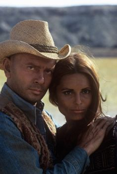 Russian-born American actor Yul Brynner (Yuliy Borisovich Briner) hugging Israeli singer and actress Daliah Lavi in the film Catlow. 1971 (Photo by Mondadori Portfolio via Getty Images)