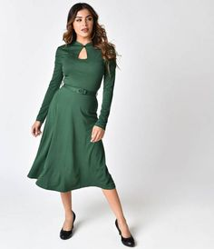 Med - Retro and captivating, what could be better? From Voodoo Vixen is a delightfully sultry emerald green dress with all the feminine grace you need! Crafted in a soft stretch blend, a classic sultry keyhole neckline is brought together with an adorable black