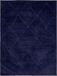 "This Turkish Trellis Shag rug is made of 100% Micro Polyester (very soft). This rug is easy-to-clean, stain resistant, and does not shed.  Colors found in this rug include: Navy Blue, . The primary color is Navy Blue.  This rug is 3/4"" thick."