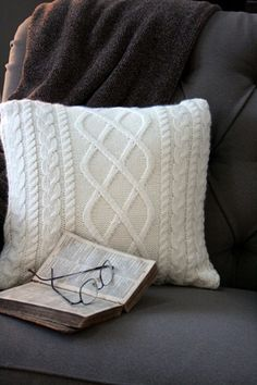 Up-cycled sweater pillow {tutorial}  I love a good project and when it is low cost, it is even better.  This is a cozy, classic and simple pillow using a thrift store sweater.