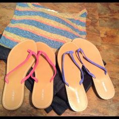 Lands End summery sandals, pink & blue  size 7 Cute summer sandals from Lands end in Pink & Blue  size 7.. The blue ones have a tiny pink mark on them which your foot will cover when being worn. The blue have no wear and the pink have slight wear on bottoms. Plz ask any questions I am always happy to answer and Happy Poshing   Lands' End Shoes Sandals