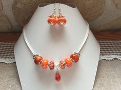 Parure charm's , orange ,avec perles variées et goutte de cristal  réf 791 de la boutique perlesacoco sur Etsy