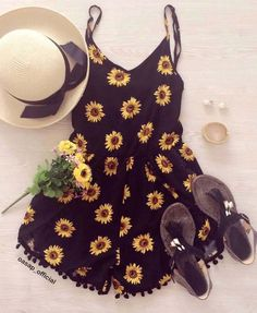 Stand out with this stunning Sunflower Print Pompon Deco Romper.  This romper featuring sunflower pattern, adjustable strapes, pleated detailing to waist, back hidden zipper and Pom pom edges.