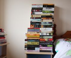 The stack of books by your bed resembles the beginning of a Jenga game.