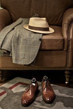 Timeless... leather armchair, fedora, jacket in Prince of Wales check and tan leather derby shoes
