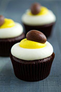 Cadbury Mini Creme Egg cupcakes for Easter: bake a frozen mini creme egg into devil's food batter; pipe buttercream frosting on top to look like the filling, and decorate with a second mini creme egg