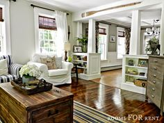 Style House-Rooms For Rent - City Farmhouse Love the bookcases & columns that divide the living room & dining room.