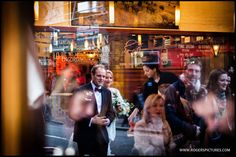 Kat and Rich reflected in the window of their favourite restaurant in Borough Market -