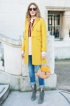 Olivia Palermo yellow coat, rolled jeans, and lace-up boots