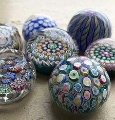 """Miniatures!  We have a variety of miniature paperweights (all under 2"""") from some of our talented Scottish artists and glass houses. Pictured here are minis from John Deacons, Peter McDougall, and Perthshire Paperweights.  #Glass #GlassArt #Mini #Miniature #Art #Scottish #Scotland #millefiori #giftideas"""