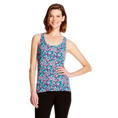 Wake up your sleep style with this Gilligan & O'Malley Women's Sleep Fluid Knit Tank Top - Botanical Blue. Covered in a chic coral and turquoise ikat-inspired print, this tank feels as good as it looks. Made of a lightweight modal-spandex blend jersey, this tank top is partially lined and hits below the hip, so you dont have to worry about it riding up. This sleepwear top has a flattering U-neck and racerback so youll want to wear it for everything from lounging on the...