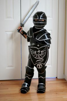 Cardboard gothic armor for 6 year-old. Made with corrugated cardboard, hot glue, paint, some elastic bands and velcro.