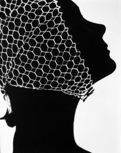 "Lillian Bassman took this photo, titled ""Mesh Hat,"" in the 1950s."