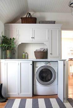 laundry room, baskets, striped rug, cabinets