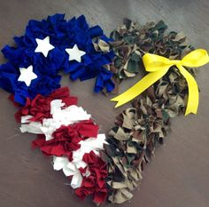 Support our heroes all year long with this patriotic & sentimental wreath! This Half My Heart is in the Army wreath features a split design with army camouflage on one half and a symbolic red, white, and blue flag on the other. This wreath also features a detachable yellow ribbon for when your love one is deployed! **MILITARY DISCOUNT AVAILABLE** contact the shop for details