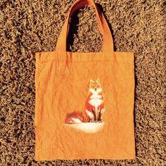 Snow Fox bag dyed orange
