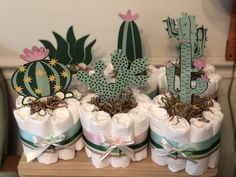 Fun Creative Ideas For a Baby Shower Gift For the New Mom. Diaper cakes are common at baby showers because they are fun and practical for the new mom. Super Cute Diaper Cake Ideas for Baby Showers. Go on and Pin it! Mexican Theme Baby Shower, Baby Shower Themes, Shower Ideas, Baby Shower Centerpieces, Baby Shower Decorations, Diaper Cake Centerpieces, Mini Diaper Cakes, Diaper Cake Boy, Cactus Cake