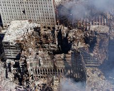 WTC 9/11 share and attribute user slagheap, via Flickr. Ground Zero, New York City, N.Y. (Sept. 17, 2001) -- An aerial view shows only a small portion of the crime scene where the World Trade Center collapsed following the Sept. 11 terrorist attack. Surrounding buildings were heavily damaged by the debris and massive force of the falling twin towers. Released U.S. Navy photo by Chief Photographer's Mate Eric J. Tilford.