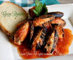 Cozze ripiene al sugo ricetta pugliese,gustoso e prelibato secondo piatto o antipasto.La ricetta della cozze ripiene è facile.Basta un po' di pane raffermo