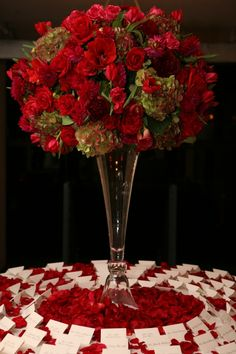 Striking red dahlias, roses, tulips, amaryllis sit alongside mixed green and red hydrangeas atop a tall cylinder vase. Red Centerpieces, Tall Wedding Centerpieces, Wedding Reception Flowers, Wedding Reception Decorations, Flower Bouquet Wedding, Wedding Ideas, Wedding Tables, Wedding 2015, Wedding Planning