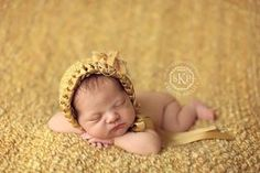 newborn girl yellow bonnet