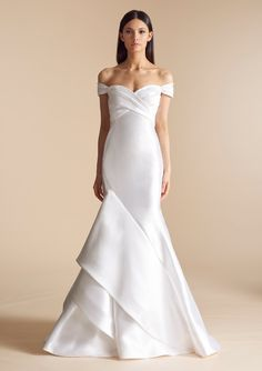 Allison Webb's collection is the embodiment of elevated elegance. Filled with clean lines, exquisite laces, and touches of delicate embroideries, the gowns are hand-crafted to amplify a bride's natural beauty. The designs, like the AW bride, are refined, modern, and imbued with a timeless sense of polish and sophistication. In stores early 2018. Check back soon to see this new collection!