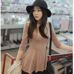tan blouse and black hat