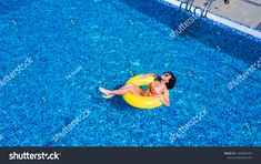 Beautiful crazy woman relaxing on inflatable ring in blue swimming pool. Art Reference, Swimming Pools, Photo Editing, Royalty Free Stock Photos, Relax, Social Media, Graphics, Website, Woman