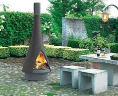 Contemporary central wood-burning stove for outdoor - PHAROS by Jos Muller - ArchiExpo