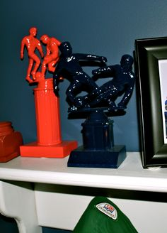 """Had originally seen the idea used on the show """"9 by Design"""", it was used as a centerpiece for a sports banquet.  I used my husbands old sports trophies (yes he still had them), spray painted them with a primer, then with a color... and it was then decor for son's bedroom!"""