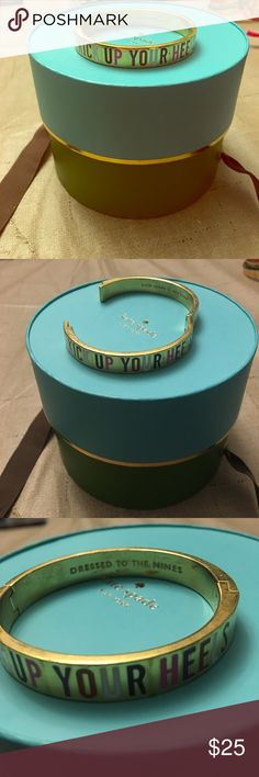 "Thin Kate Spade Kick Up Your Heels Bangle This listing is for one thin Kate Spade idiom bangle. On the outside it says ""KICK UP YOUR HEELS"" in multiple colors and ""DRESSED TO THE NINES"" is engraved on the inside. This bangs has been gently pre-loved and does show a few minor signs of wear on the inside; however, the outside is pristine. All reasonable offers will be considered! kate spade Jewelry Bracelets"