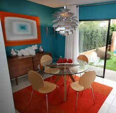 Orange and teal dining room designed by David Bromstad. After seeing this episode a while ago, it inspired the colors in my kitchen.