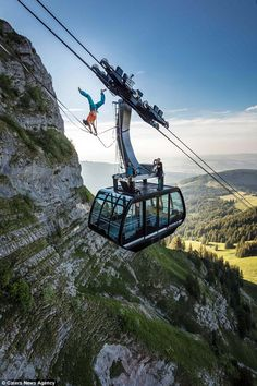Daredevil: Samuel Volery, 33 does a handstand between two cable cars on the mountain of Moleson in Switzerland. He said: 'It was the first handstand and the steepest highline ever walked. It was great fun! Handstand, Daredevil, Switzerland, Bridge, Cable, Adventure, Mountains, Fun, Cabo