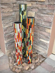 Mosaic garden pillars - Glass on PVC pipe by Peace Mosaics.this is my kind of yard art!