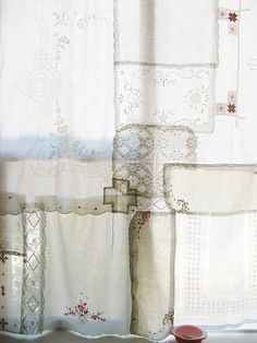 curtain from various vintage handkerchiers pieced together...I have to do this...