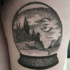 Beautiful black and grey Hogwarts tattoo by Instagram @watsonsith